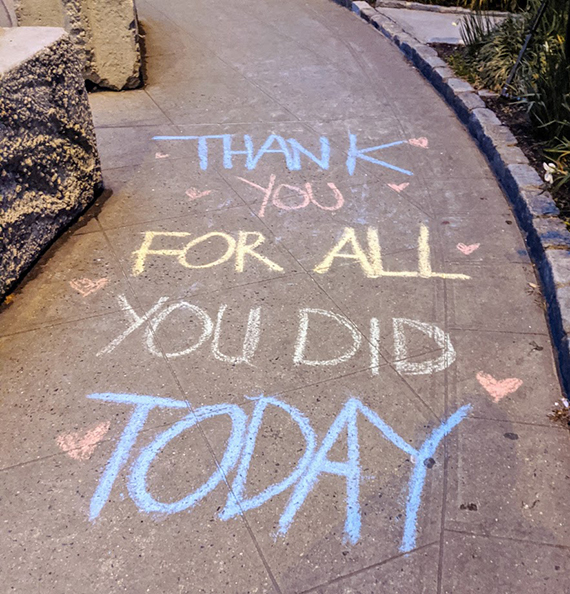 Sidewalk chalk drawing that says thank you for all you did today.
